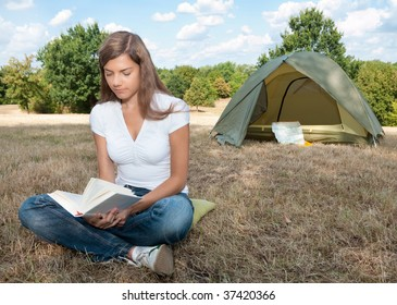 woman tent camping book
