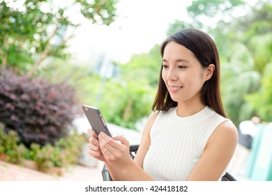 Woman texting message on smart phone