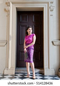 Woman in Thai silk traditional dress hold business notepad