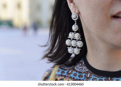 Woman that is haveing some ear jewlery. Fashion woman.