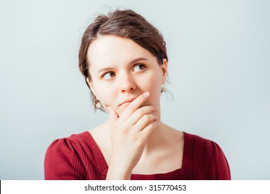 woman thinking, trying hard to remember something looking confused