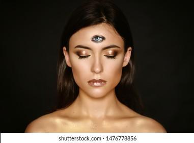 Woman with third eye on head - supernatural sense concept.