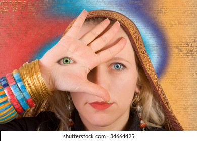 A woman with a third eye on her hand - symbol of higher consciousness