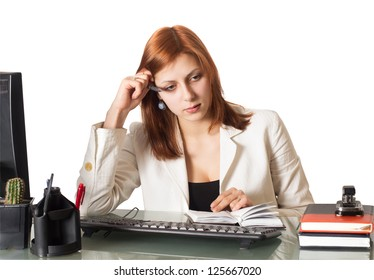 woman thought about a notebook sitting at a desk in an office on a white background isolated