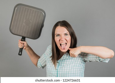 A woman threatens you with a frying pan. On a gray background