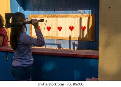 Woman throwing an axe at target for fun
