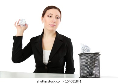 Woman throwing paper in the trash, isolated on white background
