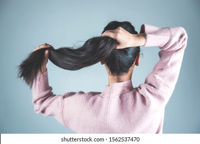 woman tie hair on gray background