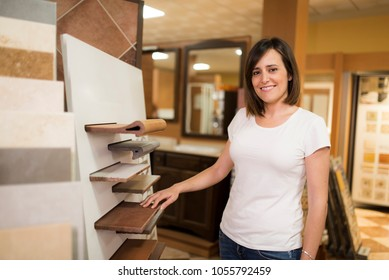 Woman in tile store looking at camera and posing