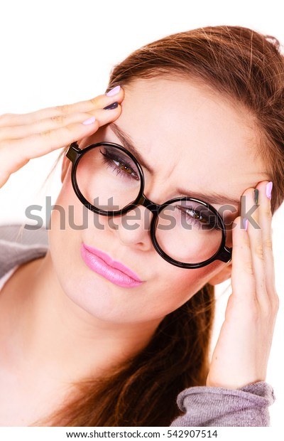 Woman tired businesswoman overworked young female suffering from head pain isolated on white. Headache, migraine and stress