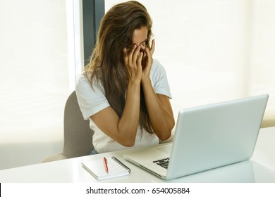 Woman is tired during work in office