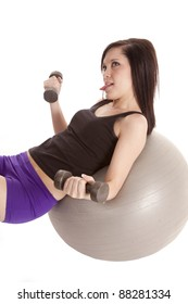 a woman tired of exercising while she is lifting weights and laying back on her exercise ball