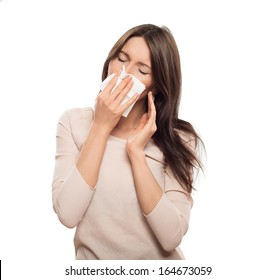 Woman with tissue catched a cold isolated on white
