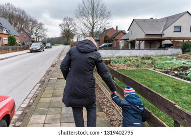 Woman with toddler on sidewalk – Kempen, Germany