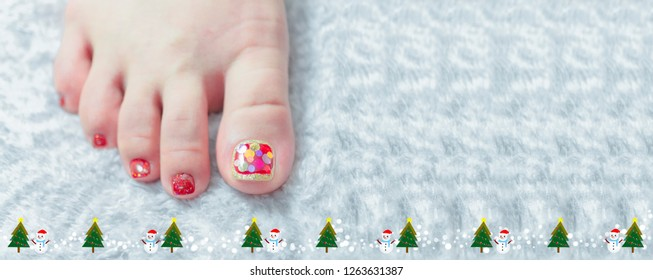 Woman toenail doing spa pedicure,painting shiny dark red gel nail art decorated with sparkling big round shape glitter design for Christmas day