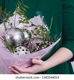 The woman took a bouquet of flowers and kitchen utensils. concept of patriarchal society and gender inequality. Sexism and feminism.