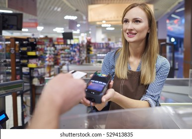 Woman took a contact less payment