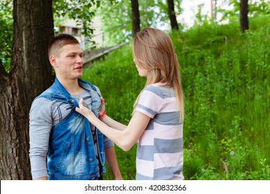 woman took her boyfriend guy by the collar. fight, violence