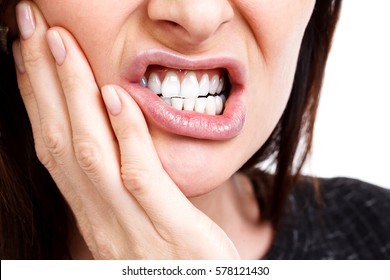 Woman with a toothpain, isolated on white background