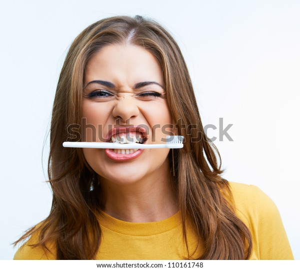 Woman with toothy brush. Isolated on white background.