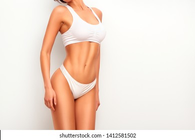 Woman in top form, perfect body shape. Parts of woman body  in underwear, studio shoot.