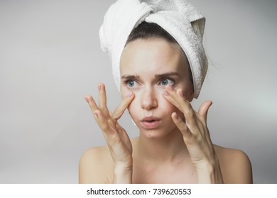 Woman touch her face,looking for wrinkles, girl after shower