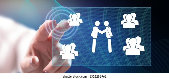 Woman touching business partnership concept on a touch screen with her finger