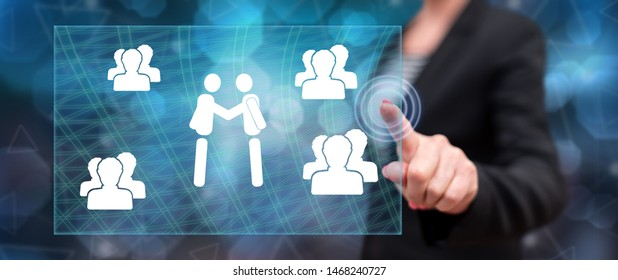 Woman touching a business partnership concept on a touch screen with her finger