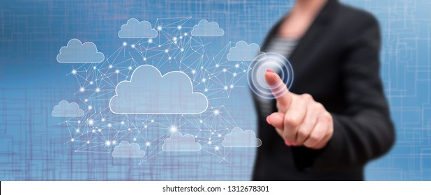 Woman touching a cloud networking concept on a touch screen with her finger