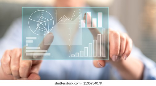 Woman touching a data analysis concept on a touch screen with her fingers