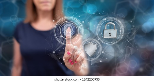 Woman touching a data security concept on a touch screen with her finger