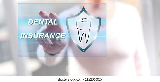 Woman touching a dental insurance concept on a touch screen with her fingers