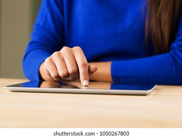 Woman touching a digital tablet
