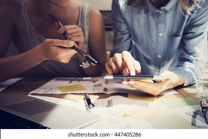Woman Touching Display Digital Tablet Hand.Project Manager Researching Process.Business Team Working Startup modern Coworking.Analyze market stock.Using electronic device,paper,note wood table.Blurred