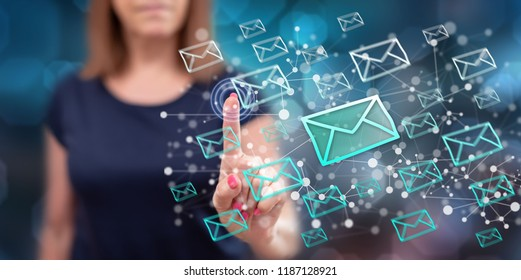Woman touching an e-mail concept on a touch screen with her finger