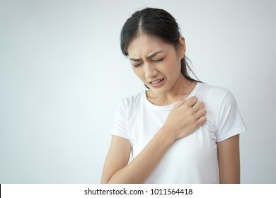 Woman touching her breast with hands. Young asian woman feel pain in her heart. isolated on withe background.