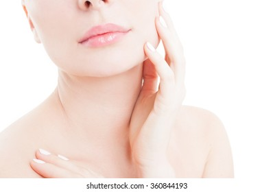 Woman touching her cheek as skin care concept on white studio background