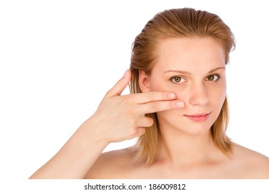 Woman touching her face with fingers