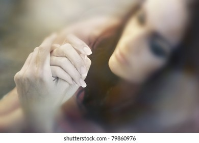 Woman touching her fingers. Focus on the hands. Shallow depth of field for artistic view