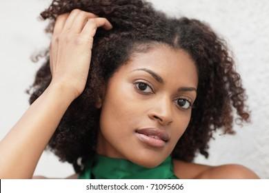 Woman touching her head