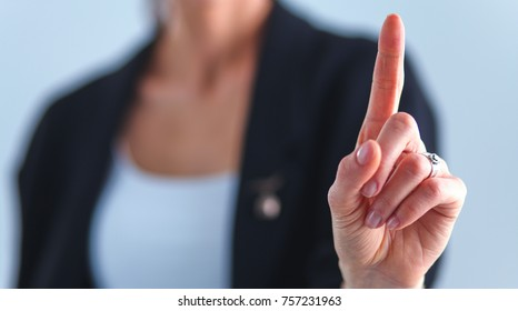 Woman touching an imaginary screen with her finger - isolated