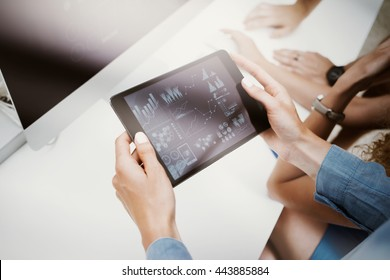 Woman Touching Screen Electronic Tablet Hand.Project Managers Researching Process.Business Team Working New Startup modern Office.HiTech Virtual Digital Charts Interfaces.Analyze market stock.Blurred