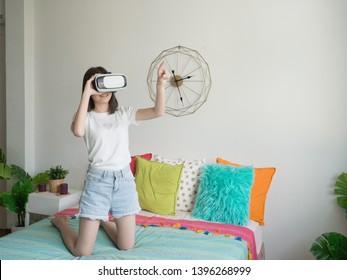 woman touching something in air during the VR experience