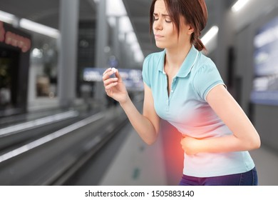 Woman touching stomach painful suffering from stomachache causes of menstruation period, gastric ulcer, appendicitis or gastrointestinal system disease. Healthcare and health insurance concept.