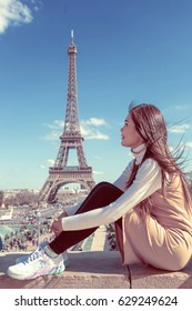 Woman touris tat the Eiffel tower in Paris, Famous popular touristic place in the world.