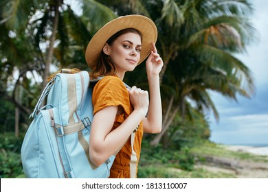 woman tourist backpack travel walk exotic palm trees