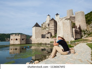 Woman Tourist enjoy on view at The Golubac Fortress a medieval fortified town, located on river Danube, eastern Serbia, Europe