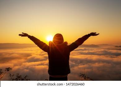 woman tourist enjoying with foggy sunrise