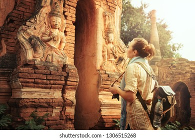 Woman tourist enjoying view a looking at Buddhist stupas in famous ancient Indein. Burma, Asia. 