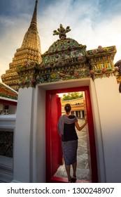 Woman tourist enter Wat Pho Bangkok Thailand